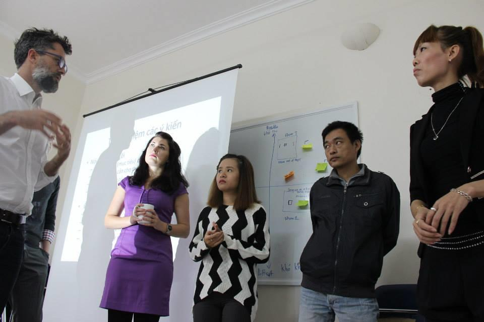 A group of International Development interns discuss plans of fundraising before presenting to work place during an Internship in Vietnam.